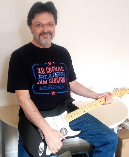 John wearing an XO Blues Cognac T shirt